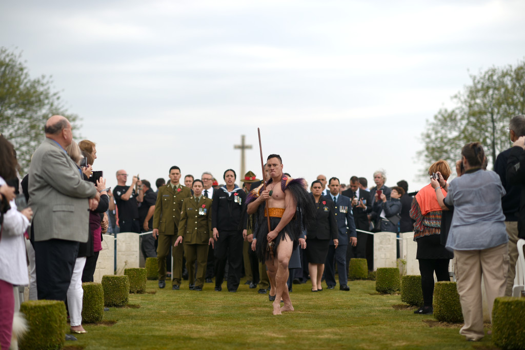 New Zealand National Commemorative Service to mark the 100th anniversary of the Battle of the Somme, Caterpillar Valley Commonwealth War Graves Cemetary, Longueval, France. New Zealand Defence Force Kaiwero, Lance Corporal Karl Manuel leads the New Zealand Defence Force Maori Cultural and the official party.